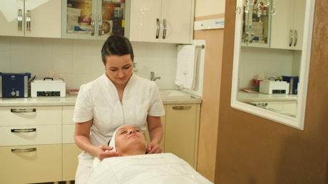 Massage Therapist giving a face massage