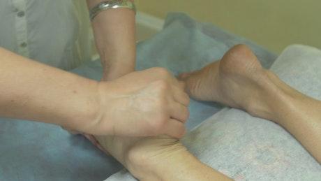 Masseuse massaging feet
