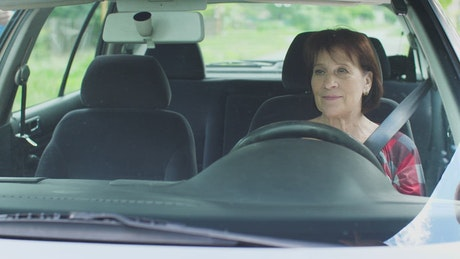 Mature woman starting her test drive