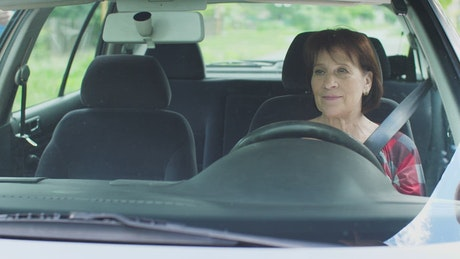 Mature woman taking a driving class