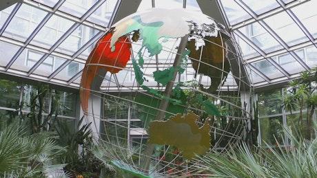 Mechanical world globe in a greenhouse