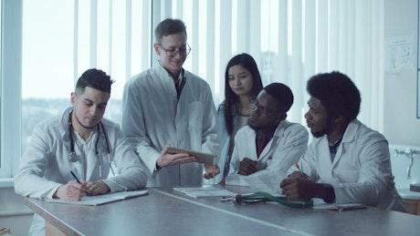 Medical students sharing notes