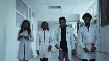 Medical students walking through the corridor