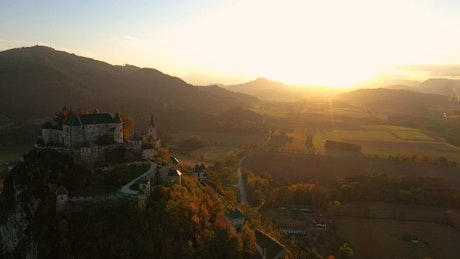 Medieval castle in the mountain at sunset