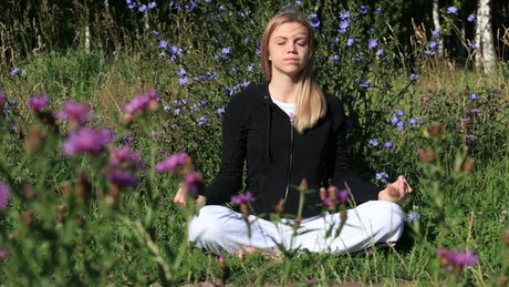 Meditating surrounded by wildflowers