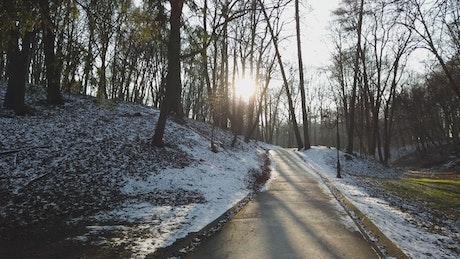 Melting snow across a park