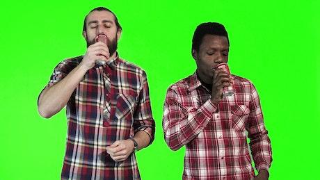 Men drinking coke on a green screen
