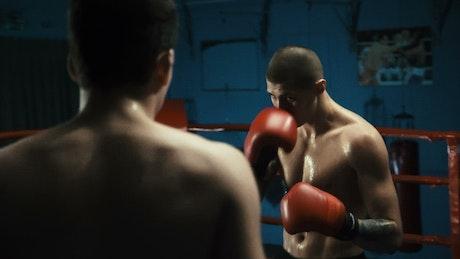 Men fighting on the ring