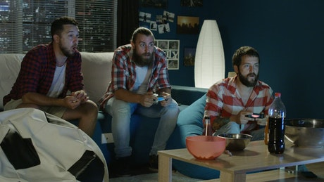 Men playing video games at home
