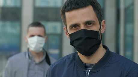 Men with face masks on the street, portrait