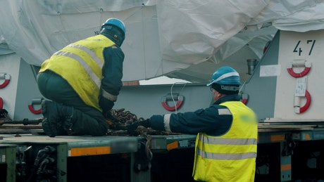 Men with helmet and vests working