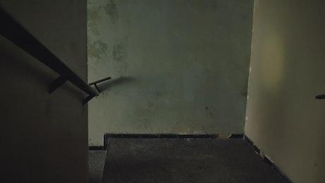 Mercenary going up the stairs aiming his gun
