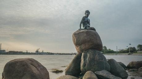 Mermaid statue by the ocean