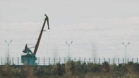 Metal crane over a port