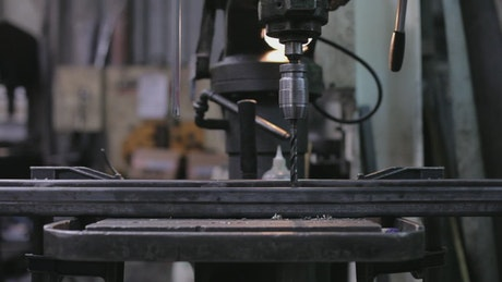 Metal drill in a factory