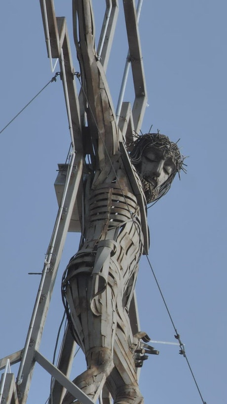 Metal sculpture of a crucified Jesus Christ