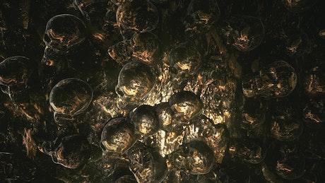 Metallic skulls in the walls of a tunnel