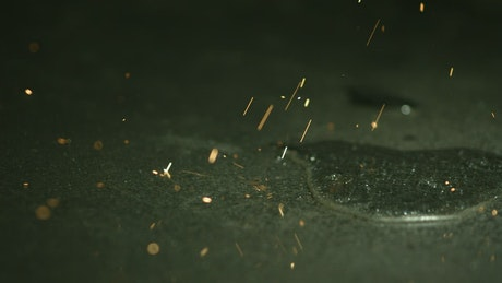 Metallic sparks in slow motion