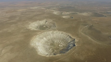 Meteor craters in the ground surface