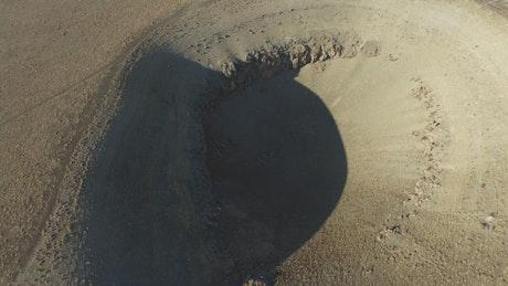Meteor sinkhole in the dry plain
