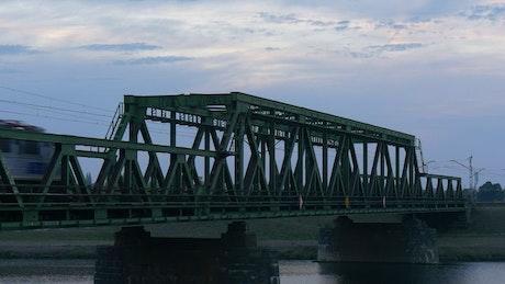 Metro crossing an iron bridge