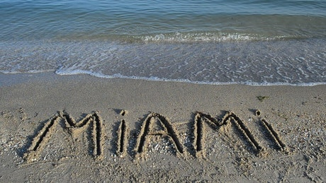"""""""Miami"""" written in the seashore sand"""