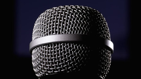 Microphone rotating on a black background