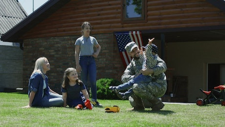 Military man and his family in the garden