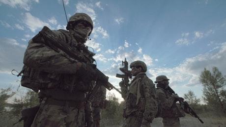 Military men posing outdoors