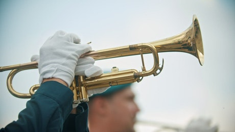 Military personal playing the trumpet