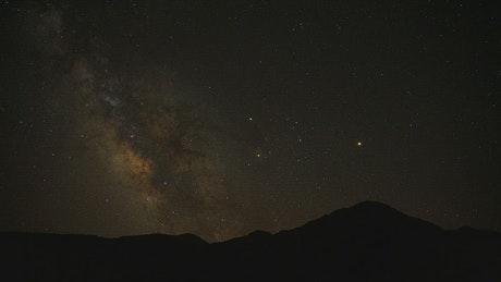 Milky way moving and mountains silhouette
