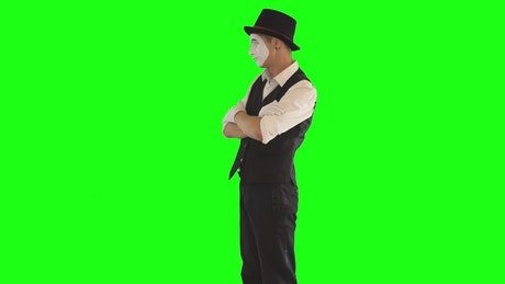 Mime flexes muscles on green screen
