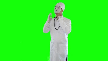 Mime imitates doctor with stethoscope on green screen