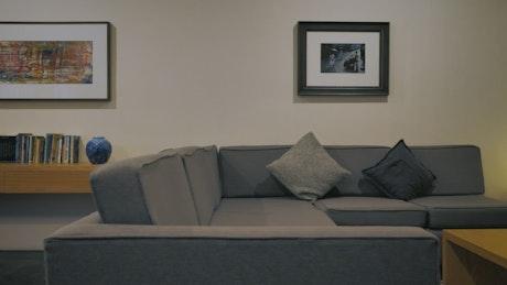 Minimalist room with gray sofa