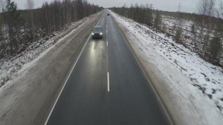 Minivan heading down a frozen road