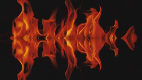 Mirror effect of flames burning on a black background