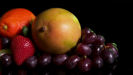 Mixed fruit on a dark table