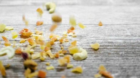 Mixed nuts falling onto a table