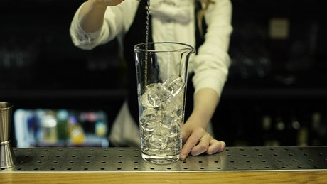 Mixing ice in a cocktail glass