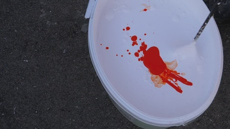 Mixing paint in a bucket