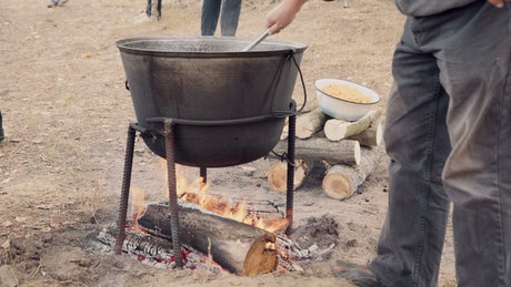 Mixing the cauldron over the fire