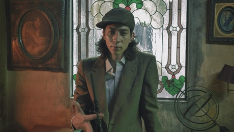 Mobster aiming his pistol in an old-fashioned setting