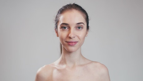 Model demonstrates acne skin care routine