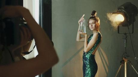 Model holds goldfish in bag for photo shoot