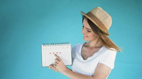 Model points at days on calendar for instagram reveal