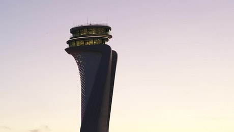 Modern airport tower against the sunset