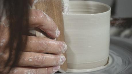 Molding clay pot on the pottery wheel