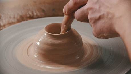 Molding with clay on the spinning wheel