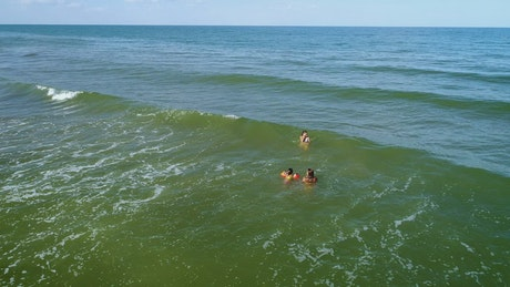 Mom and daughters swimming in the sea