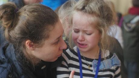 Mom comforting his crying girl